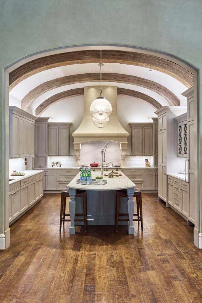 Arch vaulted ceiling adds old world style to a traditional kitchen. Photo provided by The Kitchen Source.