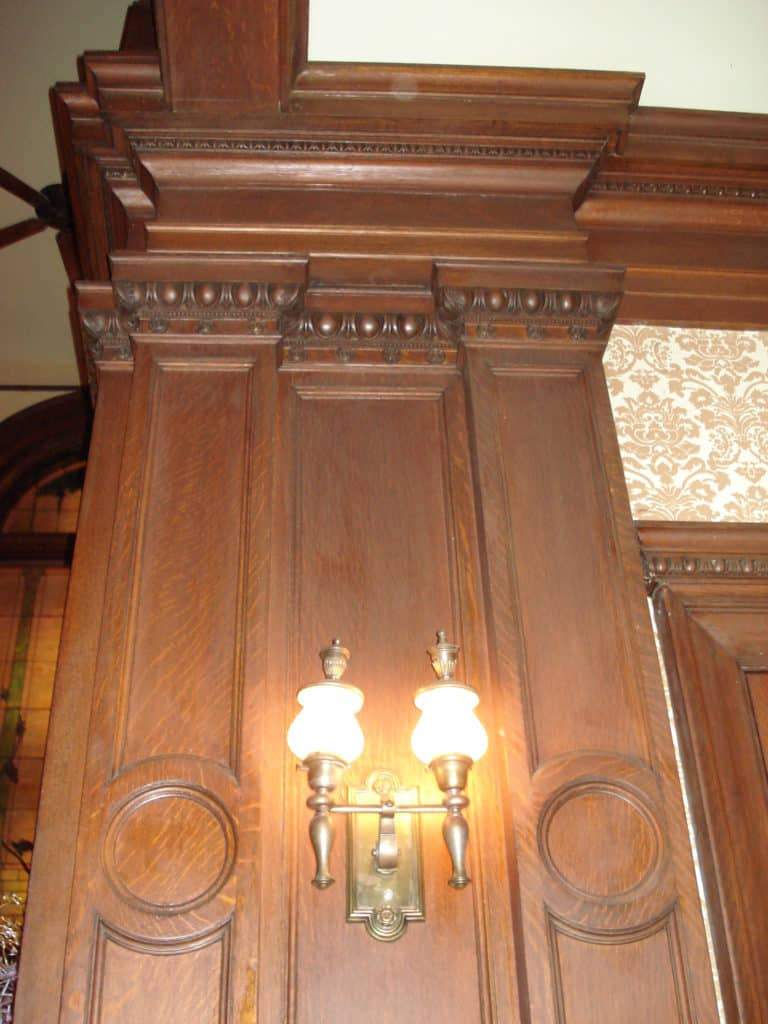 Custom hand carved wood work and original light fixture