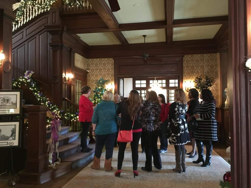 Visitors on a home tour at the Alexander Mansion