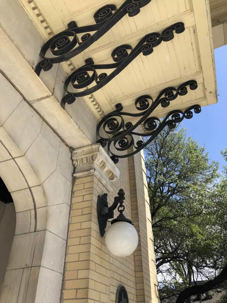 Close up of exterior details at the Alexander Mansion's entrance porch