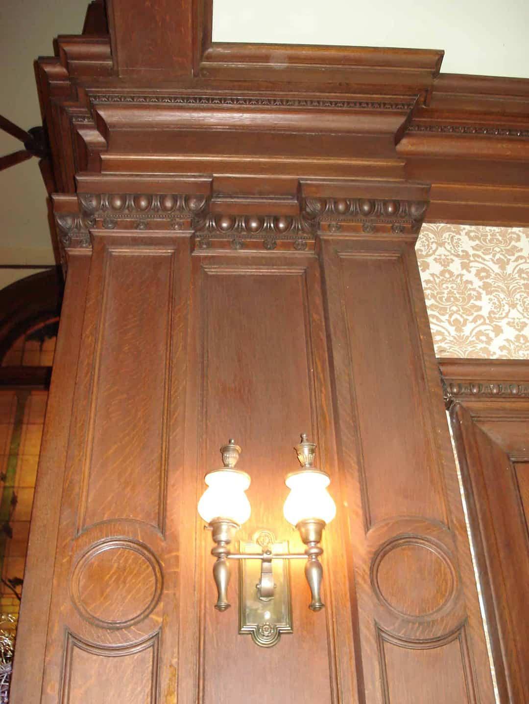 Custom hand carved wood work and original light fixture