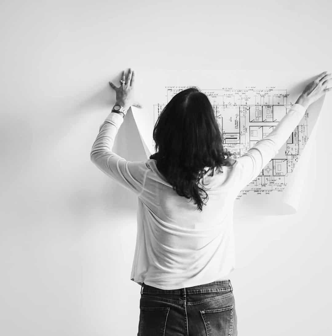 architect pinning up drawing