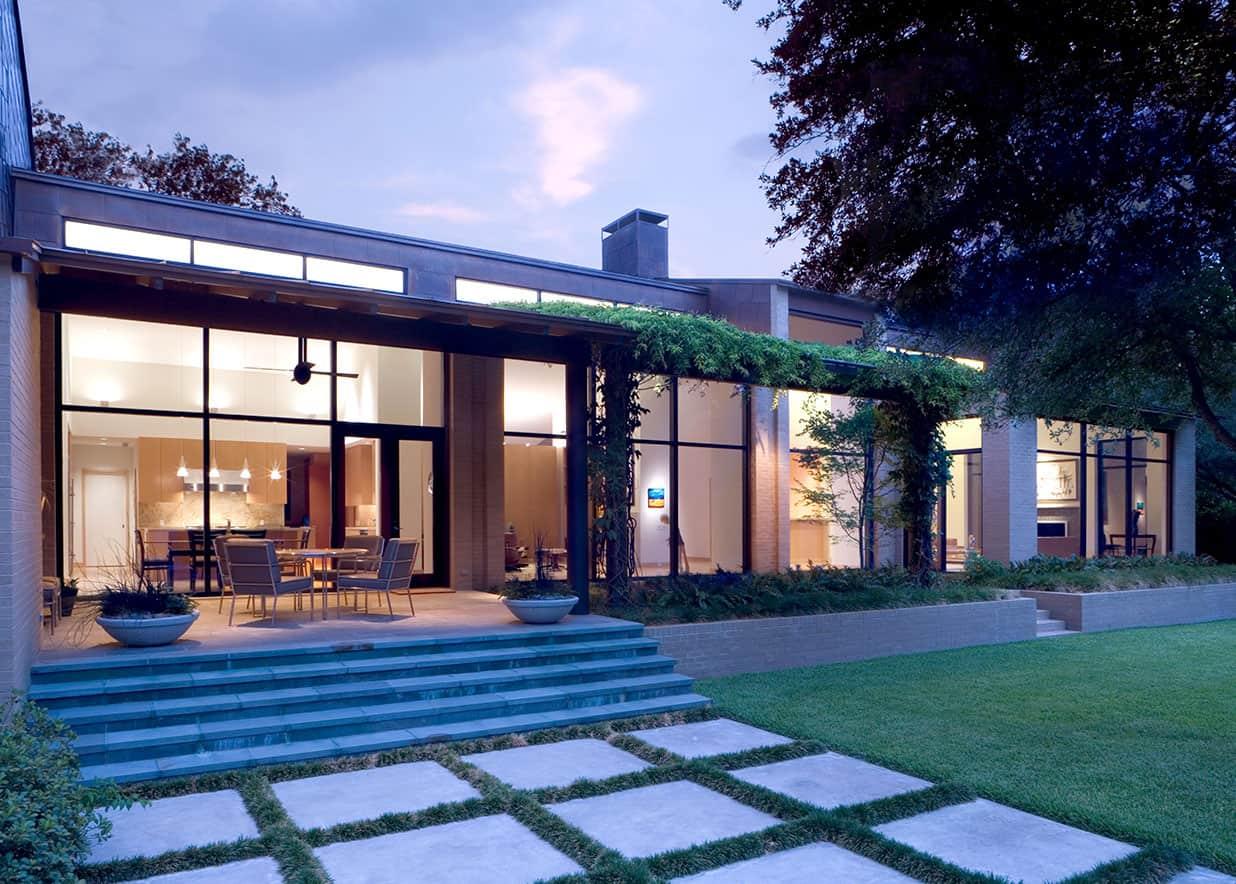 Backyard home walkway and patio - evening