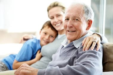 Senior man sitting with daughter and grandson